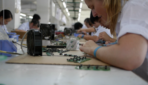 Taryn Sullivan, CEO of Efficiency Exchange, works the assembly line at a Chinese factory.