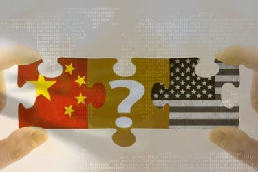 The Group of Two (G2) foreign policy. Grungy old flags of China and USA puzzle concept