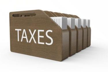 Wooden box with taxes as a concept