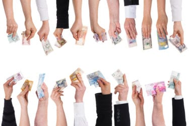 a lot of hands with important currencies isolated on white